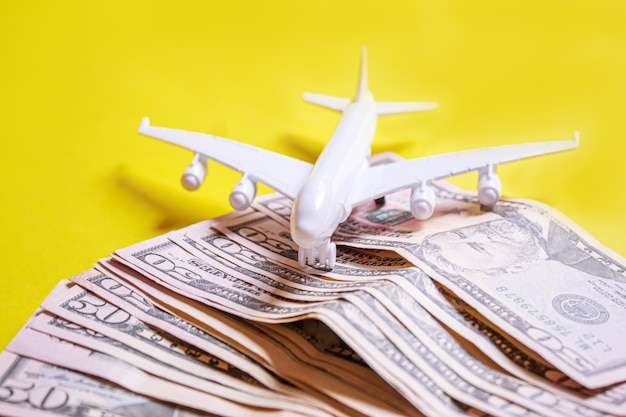 Travel preparation concept of airplane, money, passport, on yellow background. selective focus.holidays