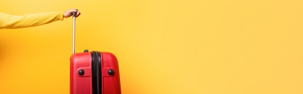 Travel red suitcase and hand over yellow