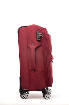 Travel red suitcase isolated