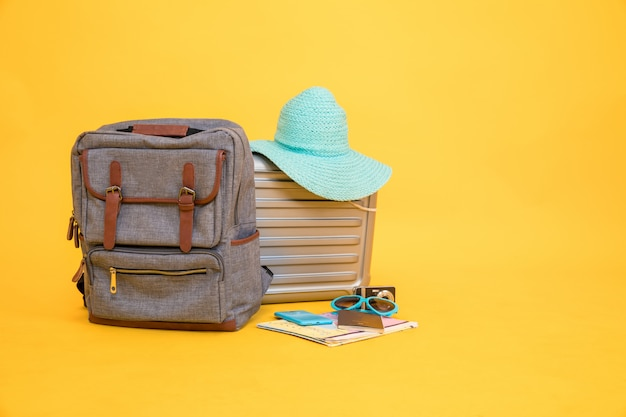 Travel-related items include vintage bags, hats, cameras, maps, sunglasses, passports, smartphones.
