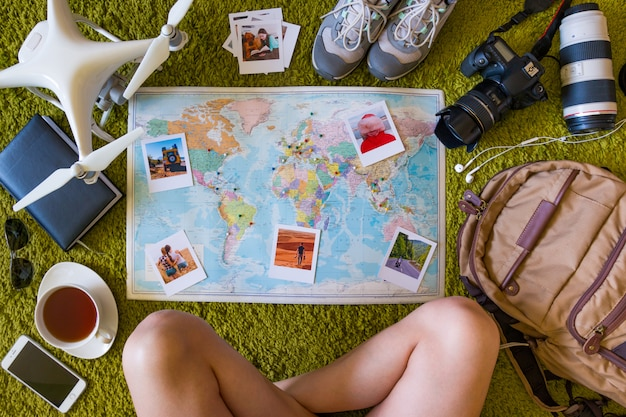 Travel set with camera, drone, backpack and map with photo memories and places