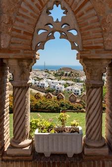 Travel sightseeing in spain looking through castle window