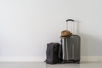 Travel suitcase with backpack and hat