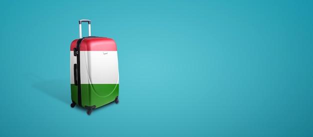 イタリアの旗が付いた旅行スーツケース。