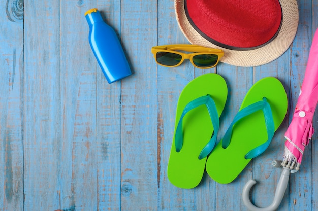 Travel,summer accessories on blue wood