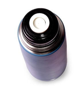 Travel thermos for hot drinks on white surface