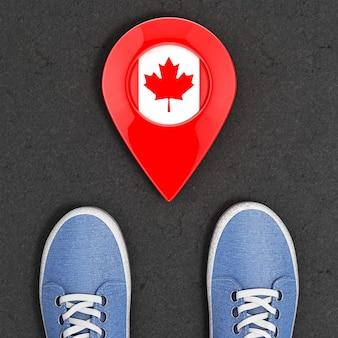 カナダコンセプトへの旅。マップポインターとカナダの旗のトップビューの極端なクローズアップとアスファルト道路上の青いデニムスニーカー。 3dレンダリング