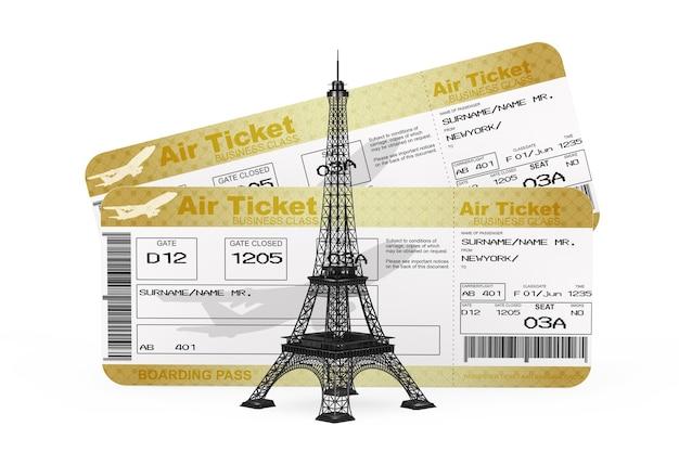 フランスのコンセプトへの旅。白い背景の上の2つのゴールデンビジネスまたはファーストクラスの航空会社の搭乗券フライエアチケットの前にあるパリエッフェル塔。 3dレンダリング