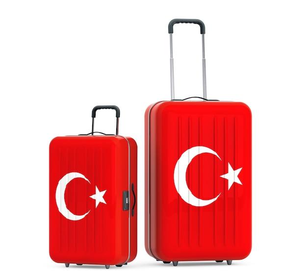 Путешествие в турцию concep. чемоданы с флагом турции на белом фоне. 3d рендеринг