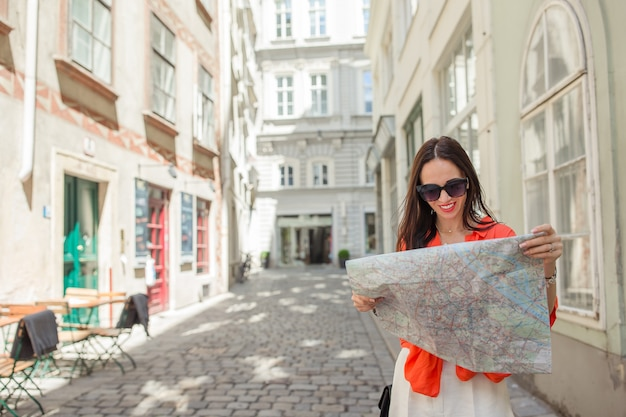 Travel tourist girl with map in vienna outdoors during holidays in europe.