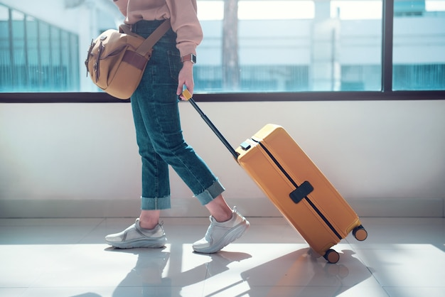 Travel tourist with luggage or suitcase at airport