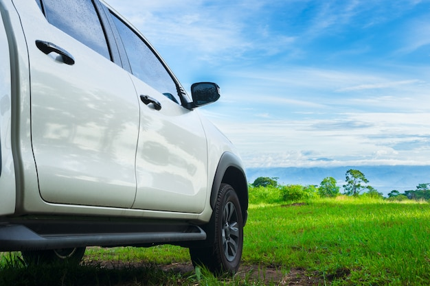 Travel with pickup car in nature, rural tropical forest in the summer.