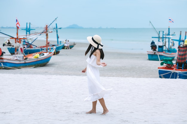 Travel woman walking on beach