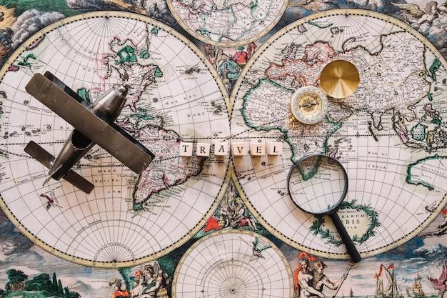 Travel writing on map near tourist stuff