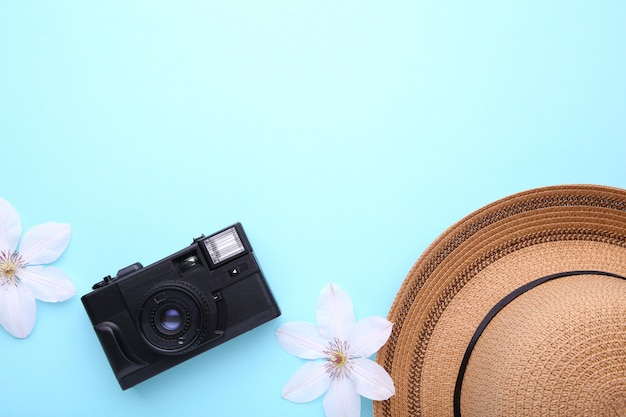 Traveler accessories on blue travel vacation concept.