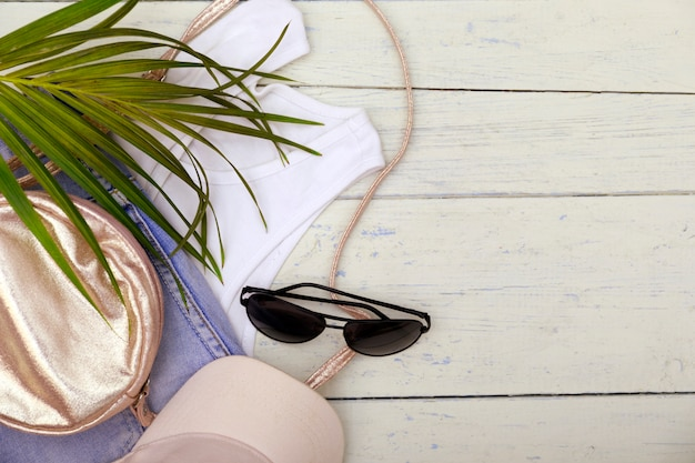 Traveler accessories, tropical palm leaf branches.
