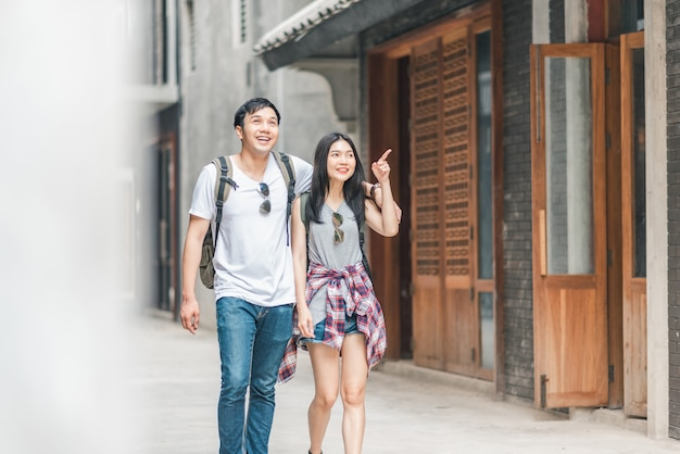 Traveler asian backpacker couple feeling happy traveling in beijing, china