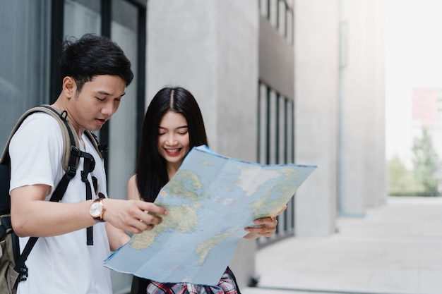 Traveler asian couple direction on location map in beijing, china