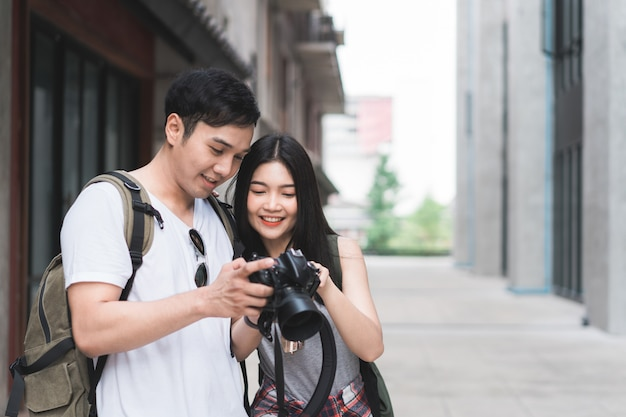 Traveler asian couple using camera for take a picture while spending holiday trip at beijing, china