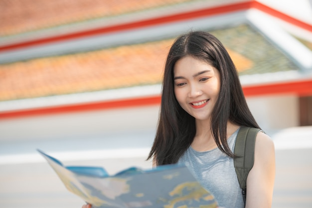 Traveler asian woman direction on location map in bangkok, thailand