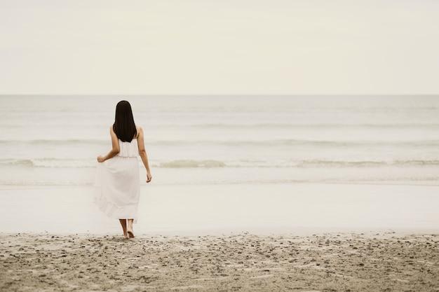 Traveler asian woman relax on beach in thailand