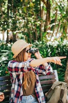 Traveler and binoculars