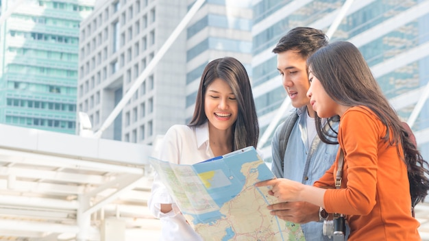 Traveler couple people use generic local and talk with adviser businesswoman