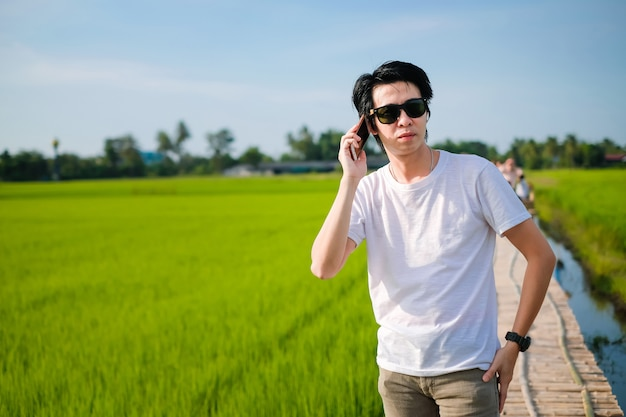 Traveler enjoying with green rice field on his holiday.