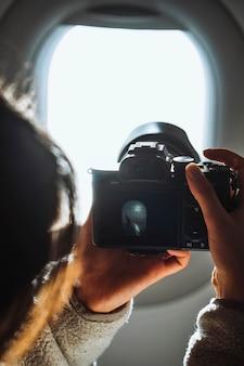 Traveler on a flight over the atlantic ocean to the faroe islands