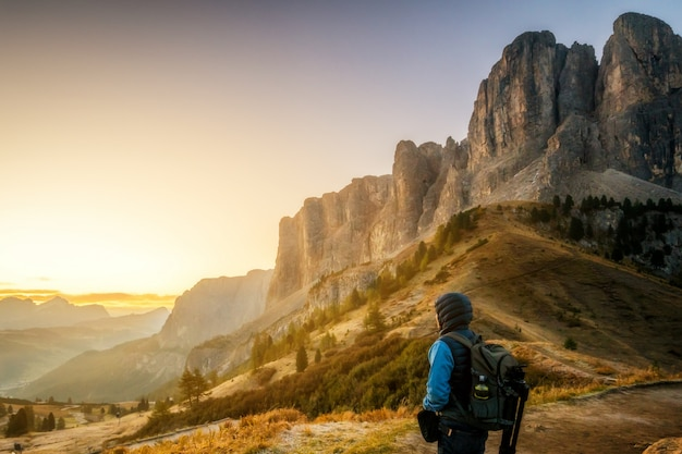 Traveler hiking breathtaking landscape of dolomite