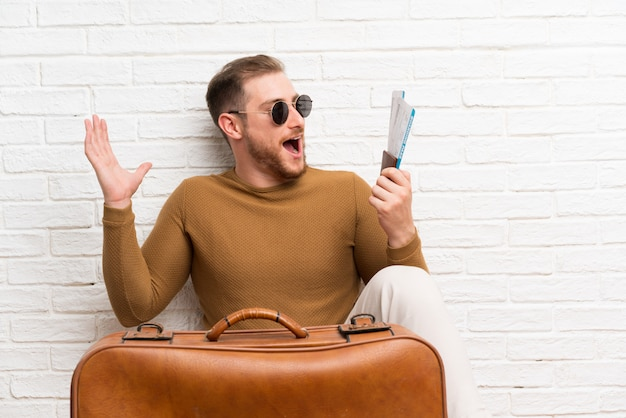 Traveler man with suitcase and boarding pass