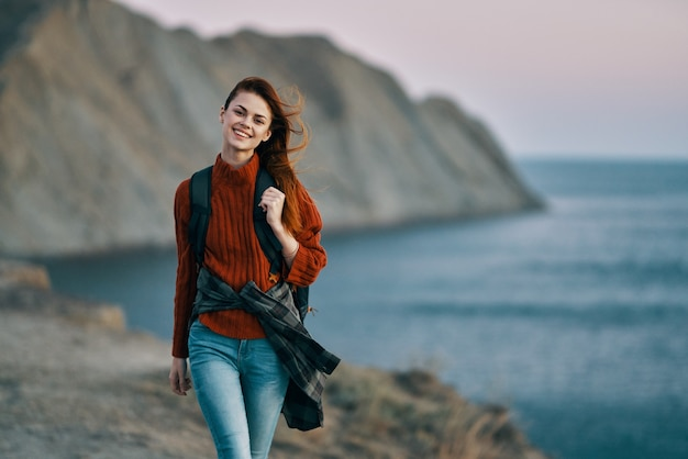Traveler in the mountains near the sea and high cliffs in the background cropped view. high quality photo