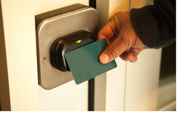 Traveler opening hotel room door by plastic keycard