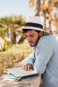 Traveler reading a book