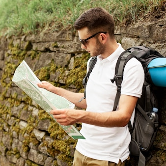 Traveler reading map