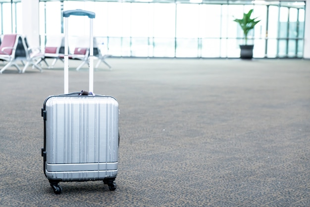 Traveler suitcases in airport terminal