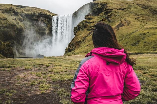 Traveler travel to skogafoss waterfall in iceland.