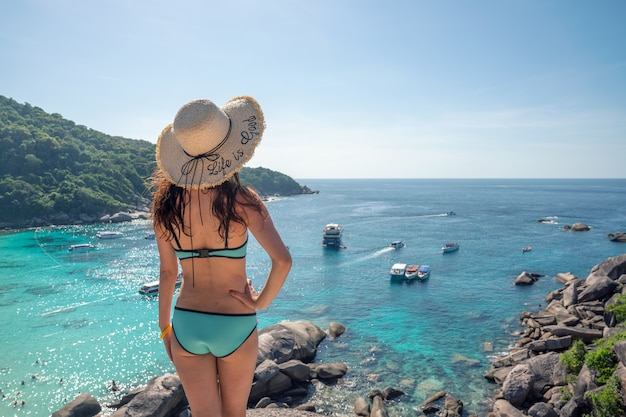 A traveler wearing swimsuit at similan island phuket ,thailand