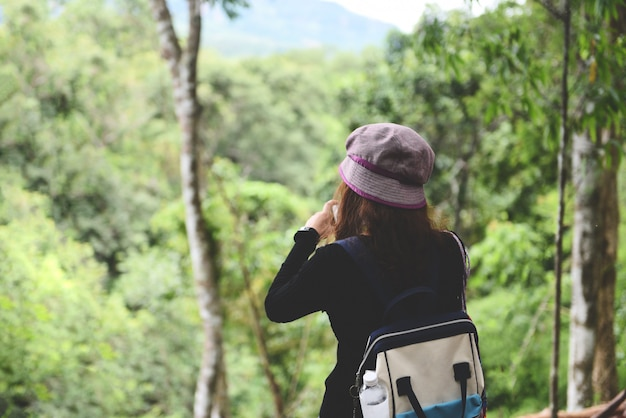Traveler woman on nature forest, female tourist on holiday vacation trips adventure travel