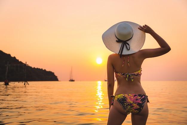 Traveler woman relaxing on beach
