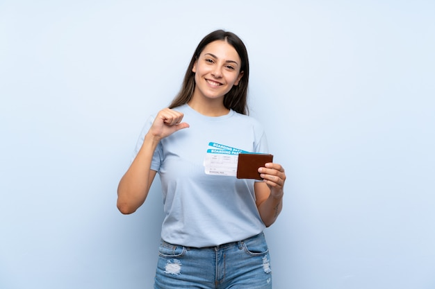 Traveler woman with boarding pass proud and self-satisfied