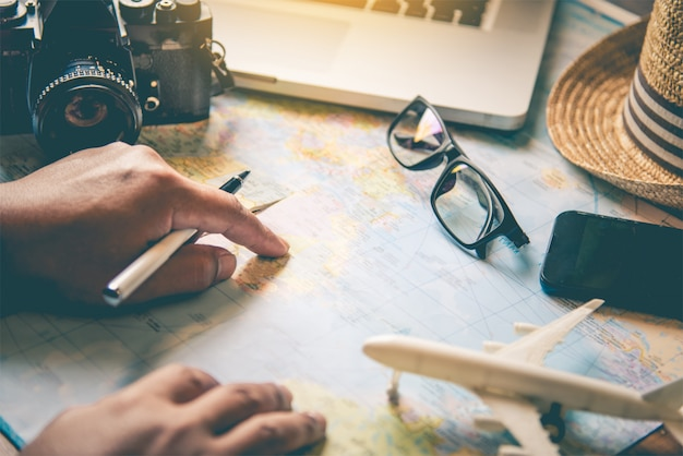 Travelers are planning a trip by searching the route on the map and searching
