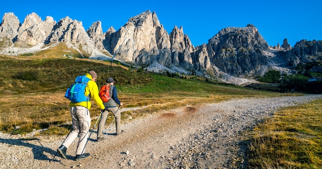 Travelers hiking landscape of dolomites