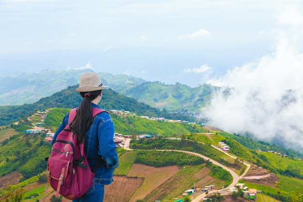 Travelers looking at phu tub berk mountain with mist, thailand