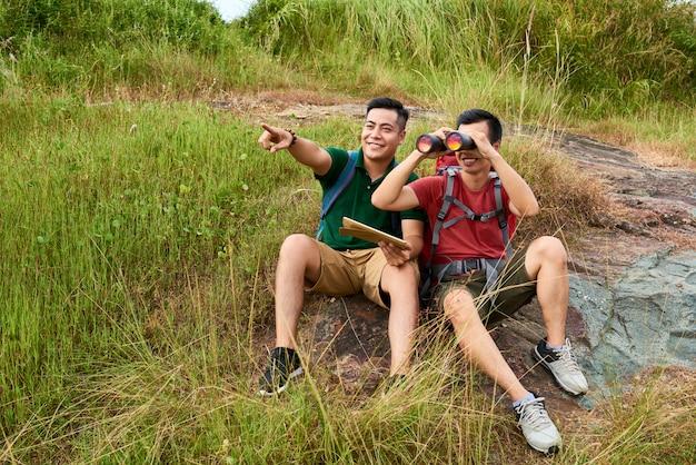 Travelers with binoculars