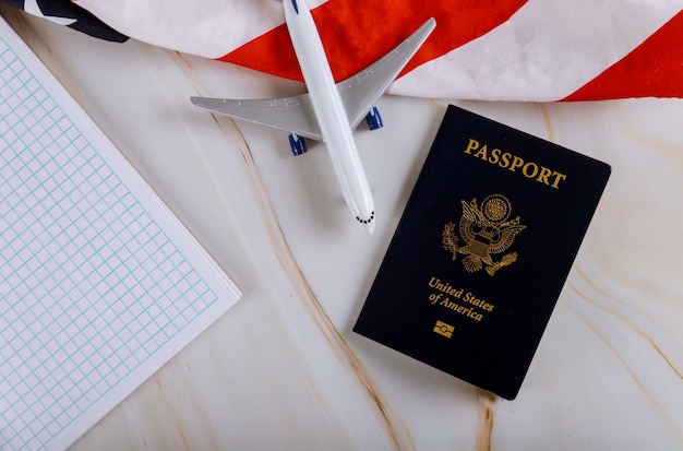 Traveling concept for preparation airplane, flat lay notebook with usa passport