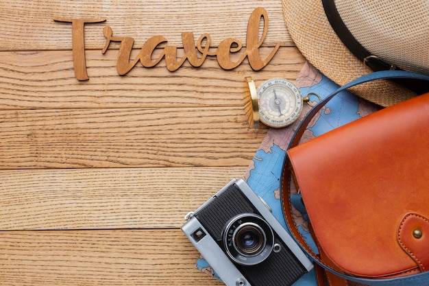 Traveling items on wooden background flat lay