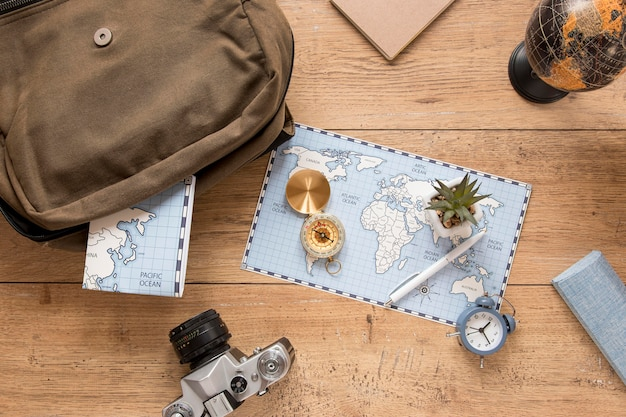 Traveling items on wooden background