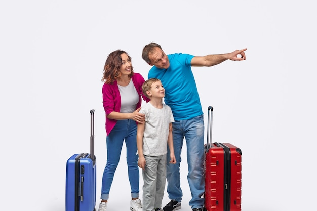 Traveling man pointing at distance for family