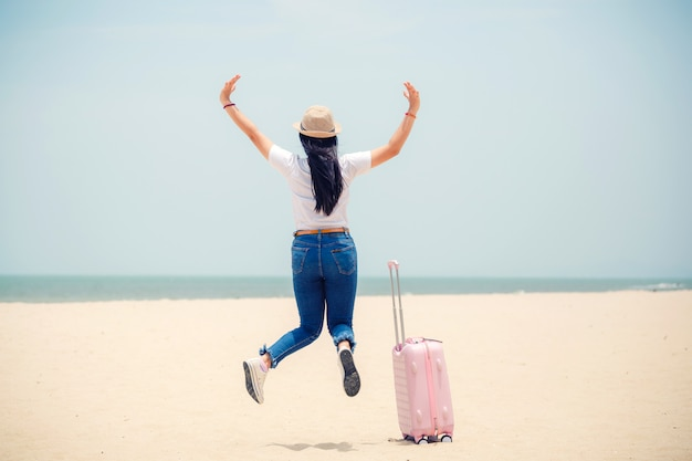 Traveling people concept young happy asian gril at the beach